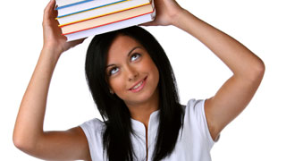 young woman holding books over her head