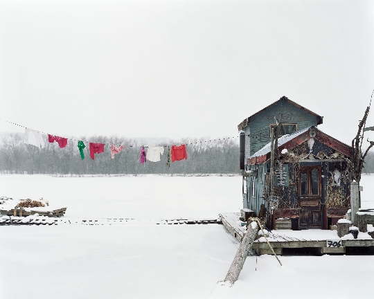 """USA. Winona, Minnesota. 2002. Peter's houseboat. Sleeping by the Mississippi. Images for use only in connection with direct publicity for the exhibition """"Gathered Leaves"""" by Alec Soth presented at Kunst Haus Wien, Austria, from February 25th and August 16th, 2020. These images are for one time non-exclusive use only and must not be electronically stored in any media asset retrieval database · Up to 2 Magnum images can be used without licence fees for online or inside print use only. Please contact Magnum to use on any front covers. · Images must be credited and captioned as outlined by Magnum Photos · Images must not be reproduced online at more than 1000 pixels without permission from Magnum Photos · Images must not be overlaid with text, cropped or altered in any way without permission from Magnum Photos."""