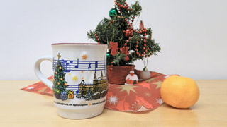 Punch cup in front of a small christmas tree