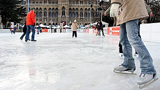 woman skating at the Vienna Ice Dream in front of the City Hall