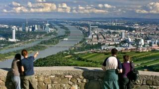 View of Vienna and the Danube river, two couples in the front