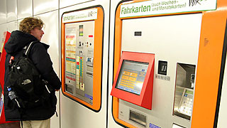 Man standing in front of a ticket machine