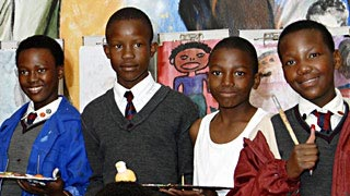 Children in front of the Masibambane College in South Africa